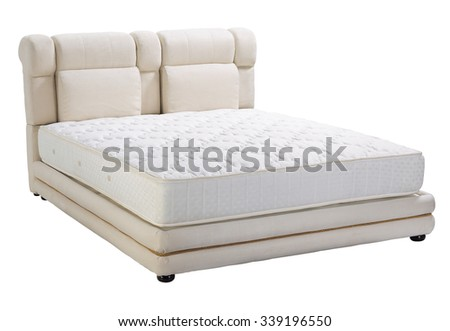 Modern platform bed with mattress - stock photo
