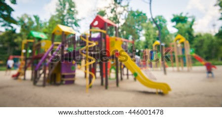 Modern Playground Equipment. Modern Colorful kids playground on yard in the park. image for background of playground, activities at public park.  - stock photo