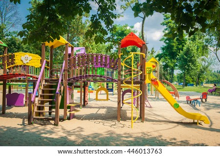 Modern Playground Equipment. Modern Colorful kids playground on yard in the park. image for background of playground, activities at public park.