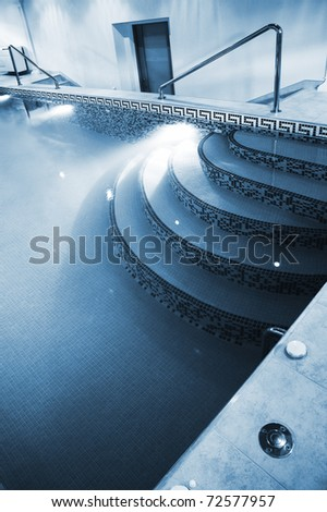 Modern pool with illumination in luxurious hotel - stock photo
