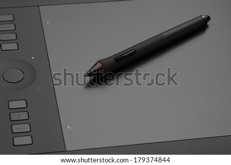 Modern professional graphics tablet for drawing closeup. - stock photo