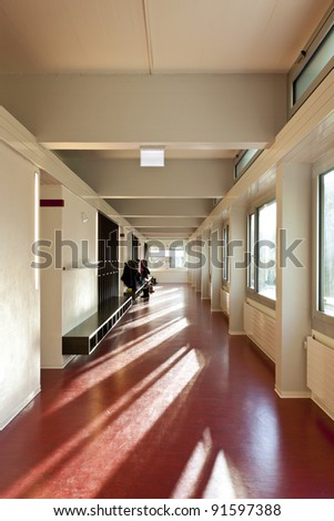 modern public school, corridor red floor