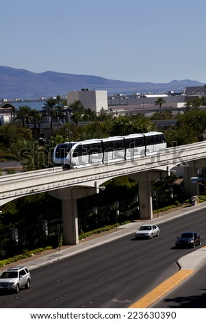 Modern public transportation with an electric monorail train system - stock photo