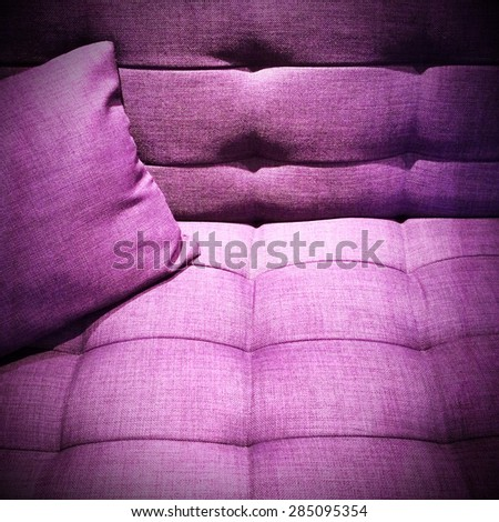 Modern purple sofa with cushion under the light. - stock photo
