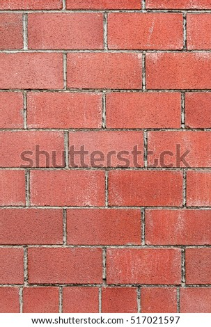 Modern red brick wall background with cracks in concrete