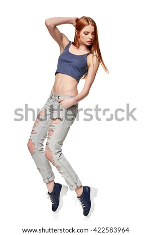 Modern red haired hip-hop style teenage girl jumping dancing isolated on a white background - stock photo