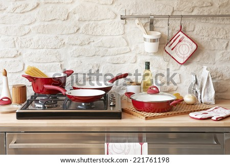 Modern red kitchen - stock photo