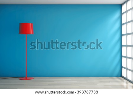 Modern Red Lamp against a blank blue wall in room - stock photo