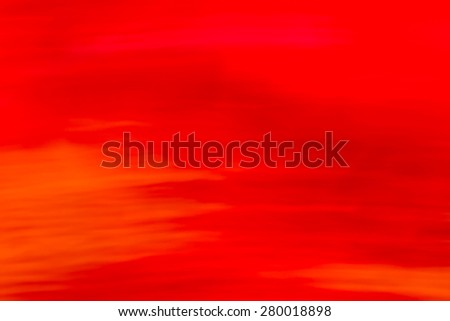 Modern red, orange background shot long exposure technique - stock photo