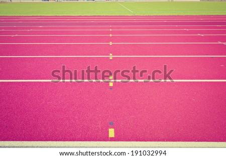 Modern Red Running Tracks of Stadium, Instagram Effect - stock photo
