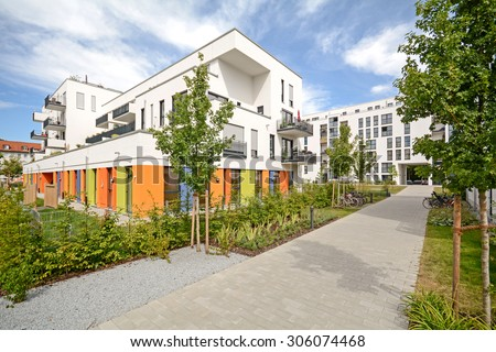 Modern residential buildings, Facade of new townhouses  - stock photo