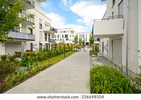 Modern residential buildings with outdoor facilities, Facade of new low-energy houses - stock photo