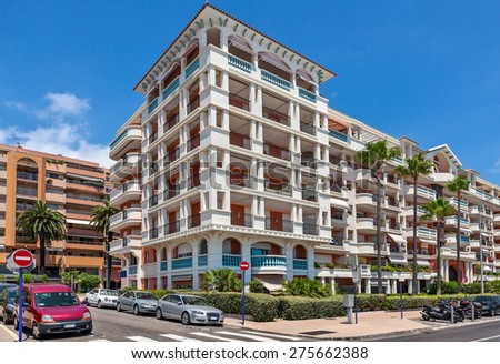 Modern residential complex under blue sky in town of Menton, France. - stock photo
