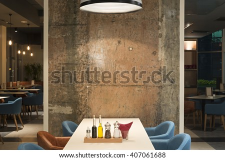 Modern restaurant interior with concrete wall - stock photo
