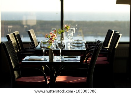 Modern restaurant interior with scenic seaside view - stock photo