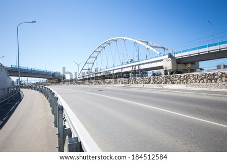 Modern road junction and a suspension bridge - stock photo