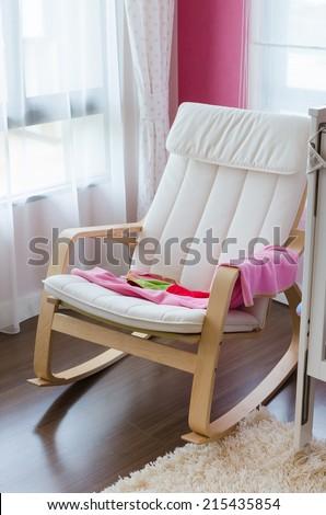 modern rocking chair in kid room - stock photo