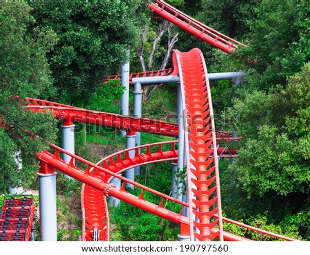 modern roller coaster of green trees - stock photo