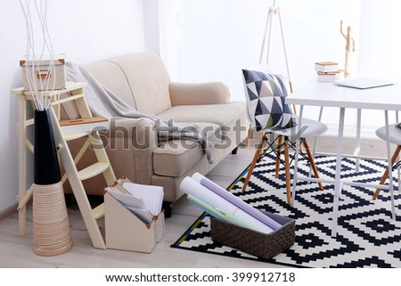Modern room design with big sofa. Furniture set with table and chairs. - stock photo