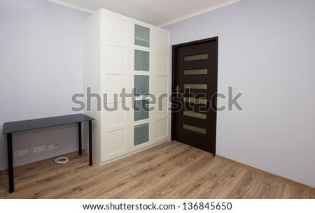 Modern room interior with big white  wardrobe - stock photo