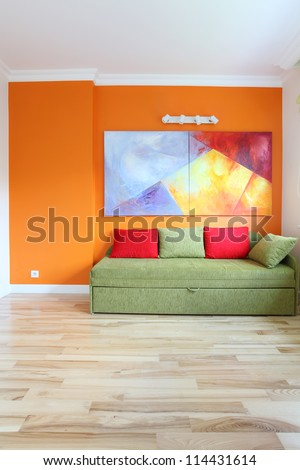 Modern room with colorful wall and sofa - stock photo
