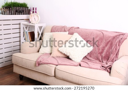 Modern room with comfortable sofa, indoors - stock photo