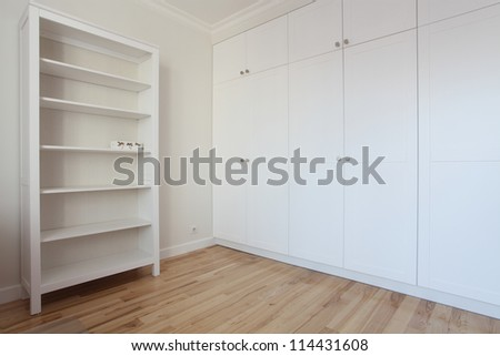 Modern room with shelf and white wardrobe - removal - stock photo