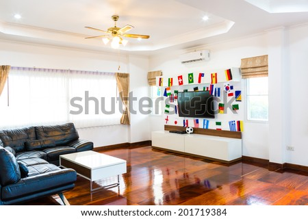 Modern room with TV and Flags for soccer championship 2014 - stock photo