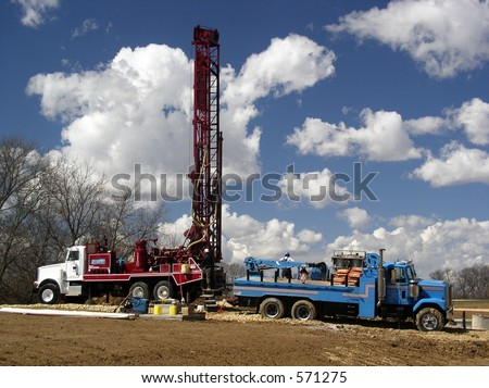 Modern rotary drill rigs bore water well - stock photo