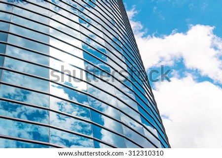 Modern round glass building in the city. - stock photo