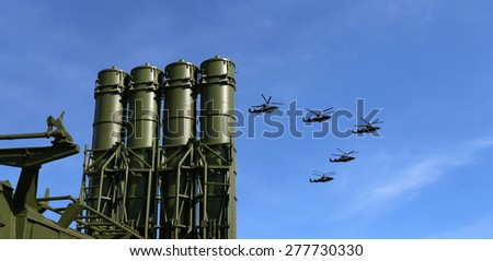 Modern Russian anti-aircraft missiles and military aircrafts fly in formation against the sky   - stock photo