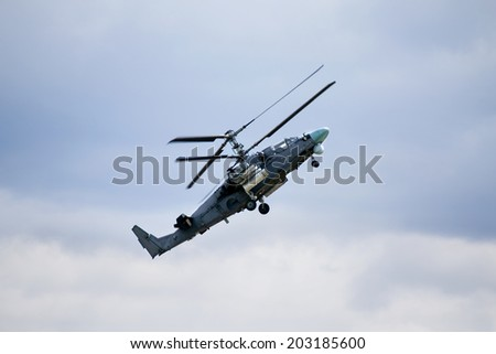 Modern russian attack helicopter in flight - stock photo