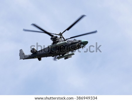 Modern russian attack helicopter with rockets, bombs, guns  - stock photo