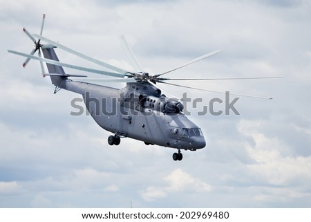 Modern russian military transport helicopter in flight - stock photo