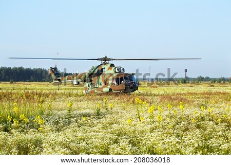 Modern russian military transport helicopter taking off - stock photo