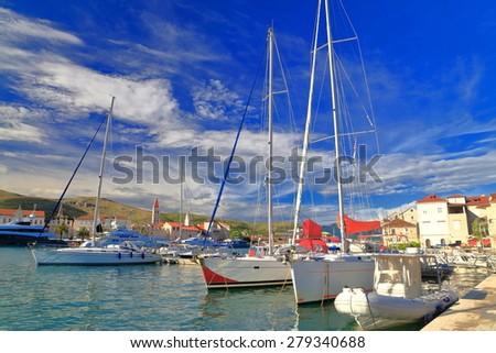 Modern sail boats anchored in sunny marina of an old Venetian town, Trogir, Croatia - stock photo