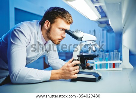 Modern scientist studying new virus in lab - stock photo
