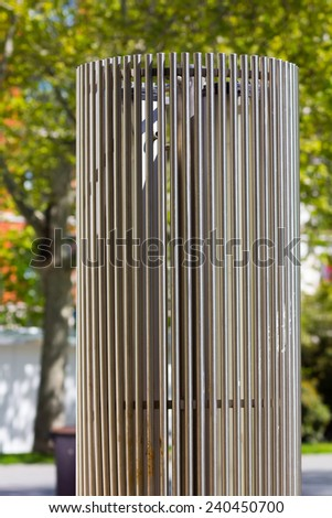 modern sculpture in steel cylindrical - stock photo