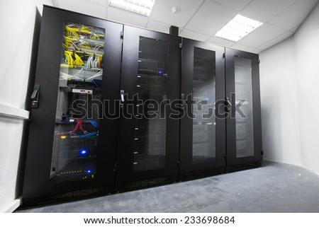 Modern server room interior with black metal computer cabinets