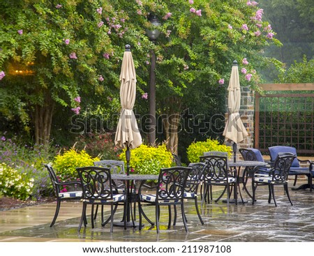 Modern set of outdoors patio furniture in a backyard - stock photo