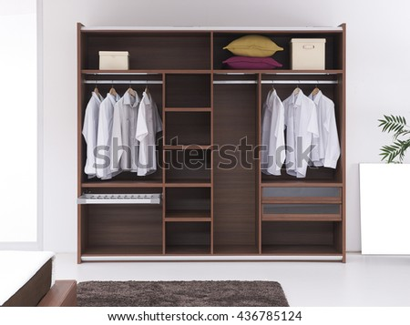 modern shirts and dress hanging on rail in wooden wardrobe at home