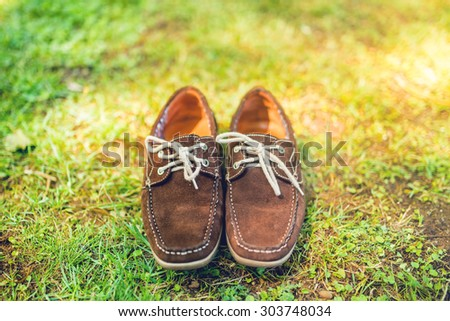 Modern shoes, elegant brown summer moccasins. Mens leather shoes, view from top, ready for catalog - stock photo