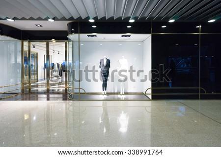 modern shopping mall interior, fashion shops in - stock photo