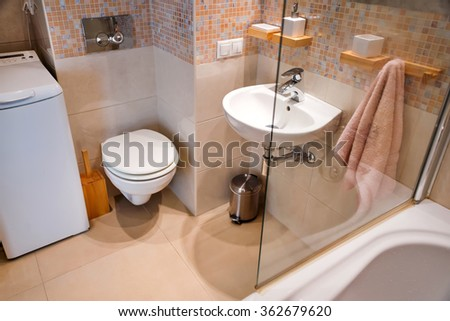 Modern simple interior in light apartments. Bathroom  interior with glass door shower and mirror