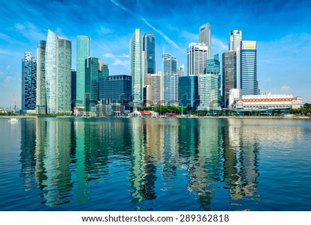 Modern Singapore city skyline of business district downtown in day with reflection in water - stock photo