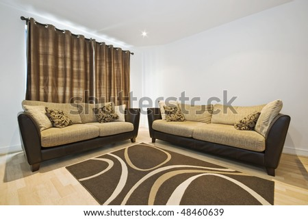 modern sitting room with designer sofas and accessory - stock photo