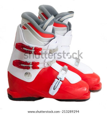 Modern ski boots for young boy isolated on white background
