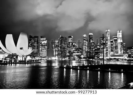 Modern skycrapers along the Singapore river in black and white tone