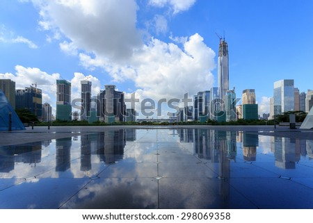 Modern skyline and buildings with empty square floor - stock photo