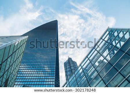 Modern skyscraper business office, sky building. development facade city, development facade modern, development facade building, development facade, development  facade glass, modern facade, sky view - stock photo